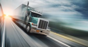 Large Semi-truck Driving On The Interstate Stock Photo