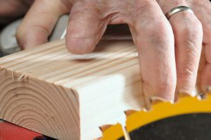 Woodworker With A Missing Finger Stock Photo