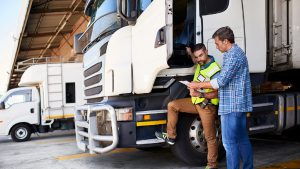 Truck Driver Making Drop Off Stock Photo