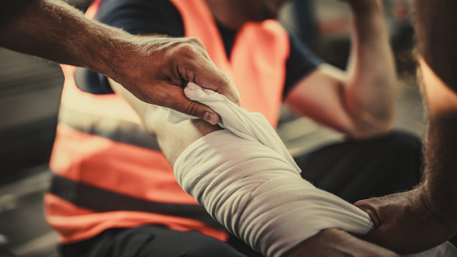 Blue Collar Worker With An Injured Arm Stock Photo