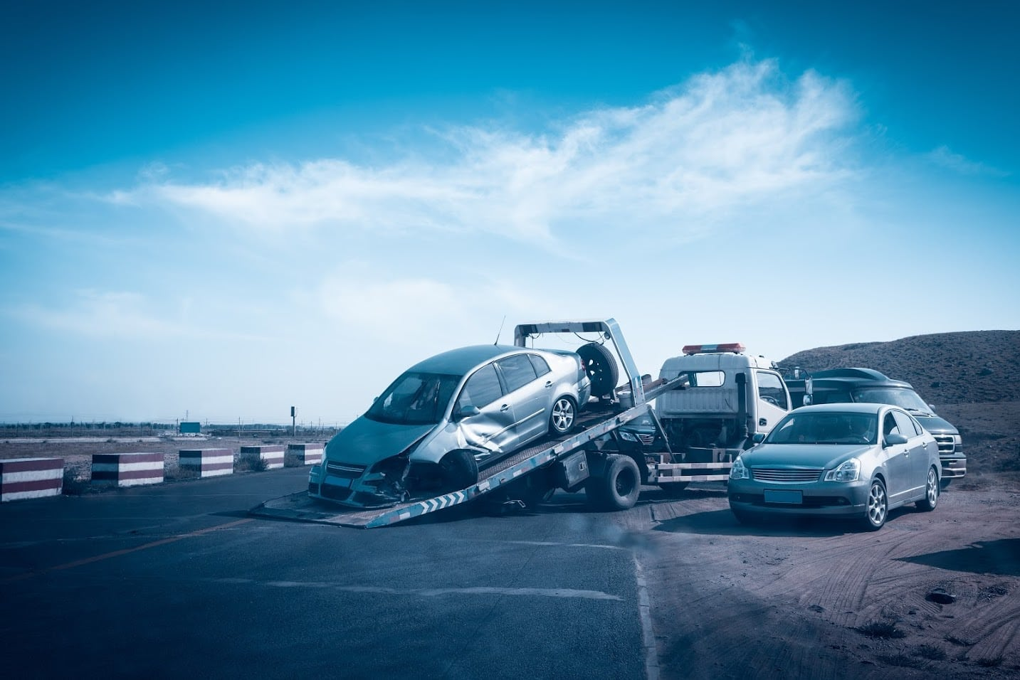 Tow Truck Towing Away A Damaged Vehicle Stock Photo