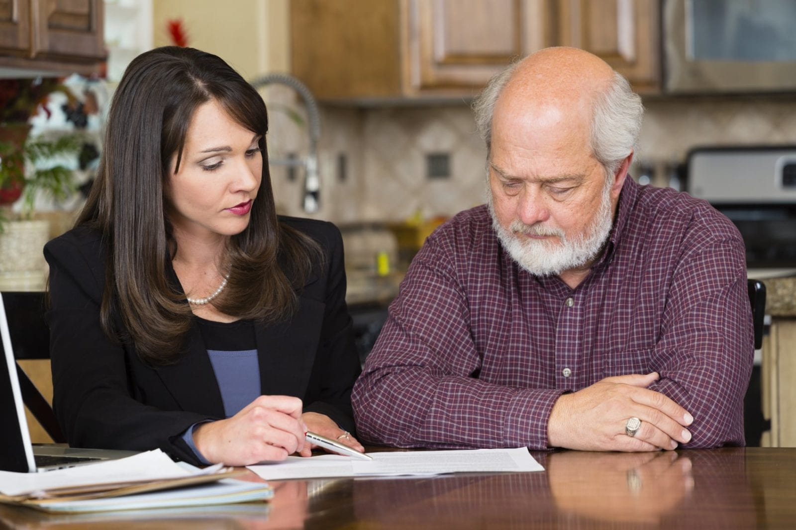 Attorney Meeting With An Elderly Client In His Home Stock Photo