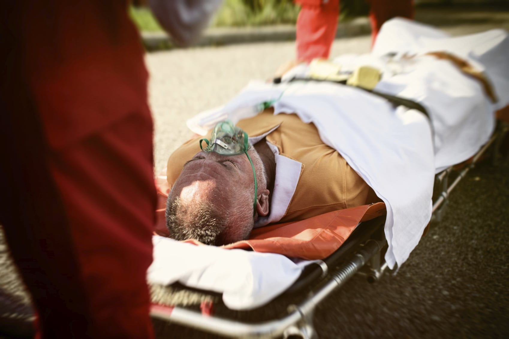 Elderly Man In A Stretcher Stock Photo