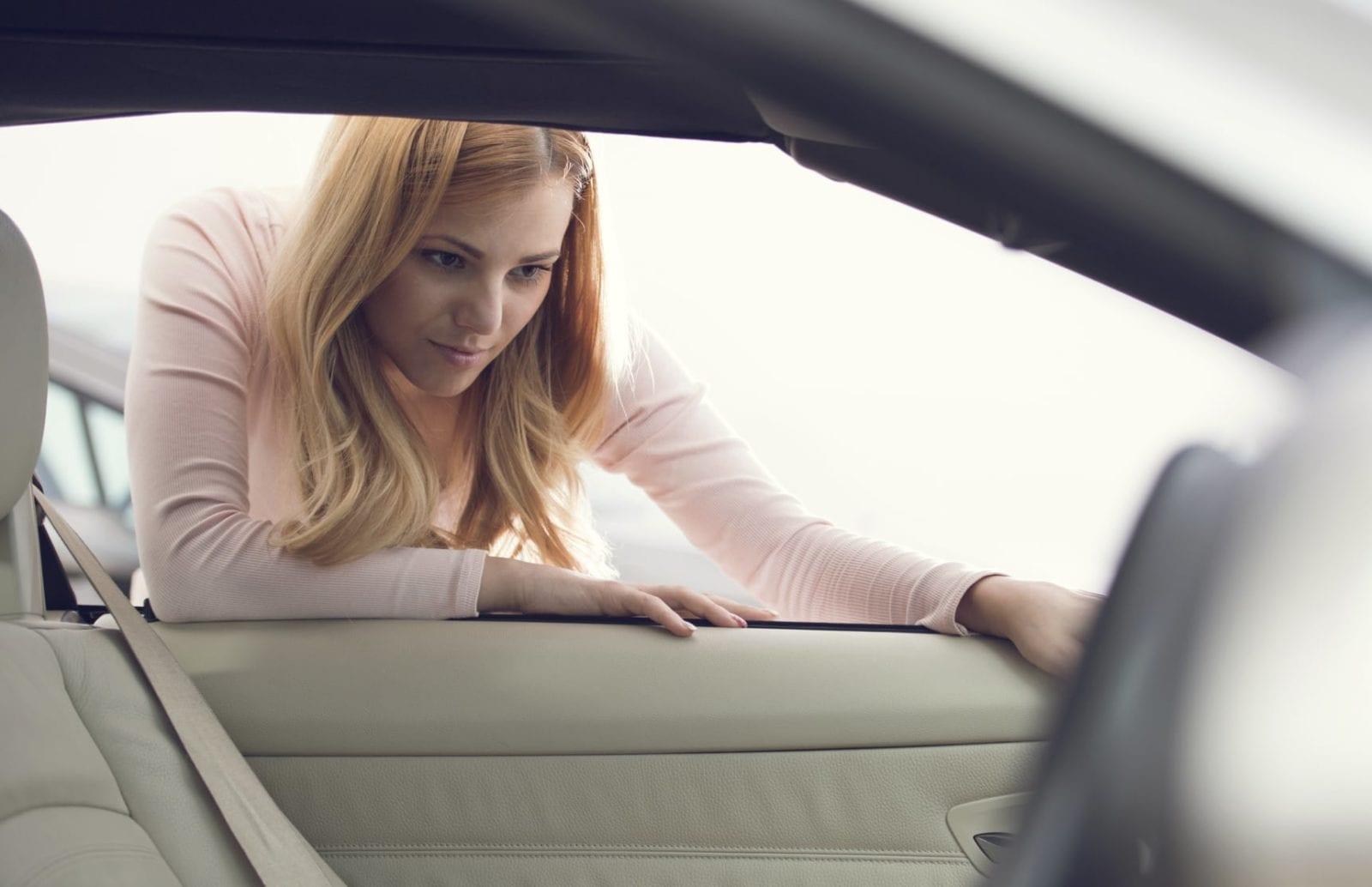 Young Woman Examining A Vehicle Stock Photo
