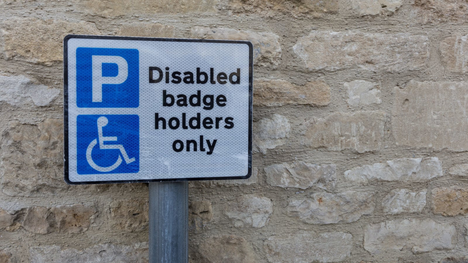 Handicapped Parking - Disabled Badge Holders Only Sign Stock Photo