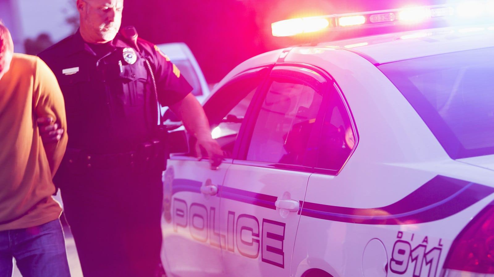 Police officer Arresting A Drunk Driver Stock Photo