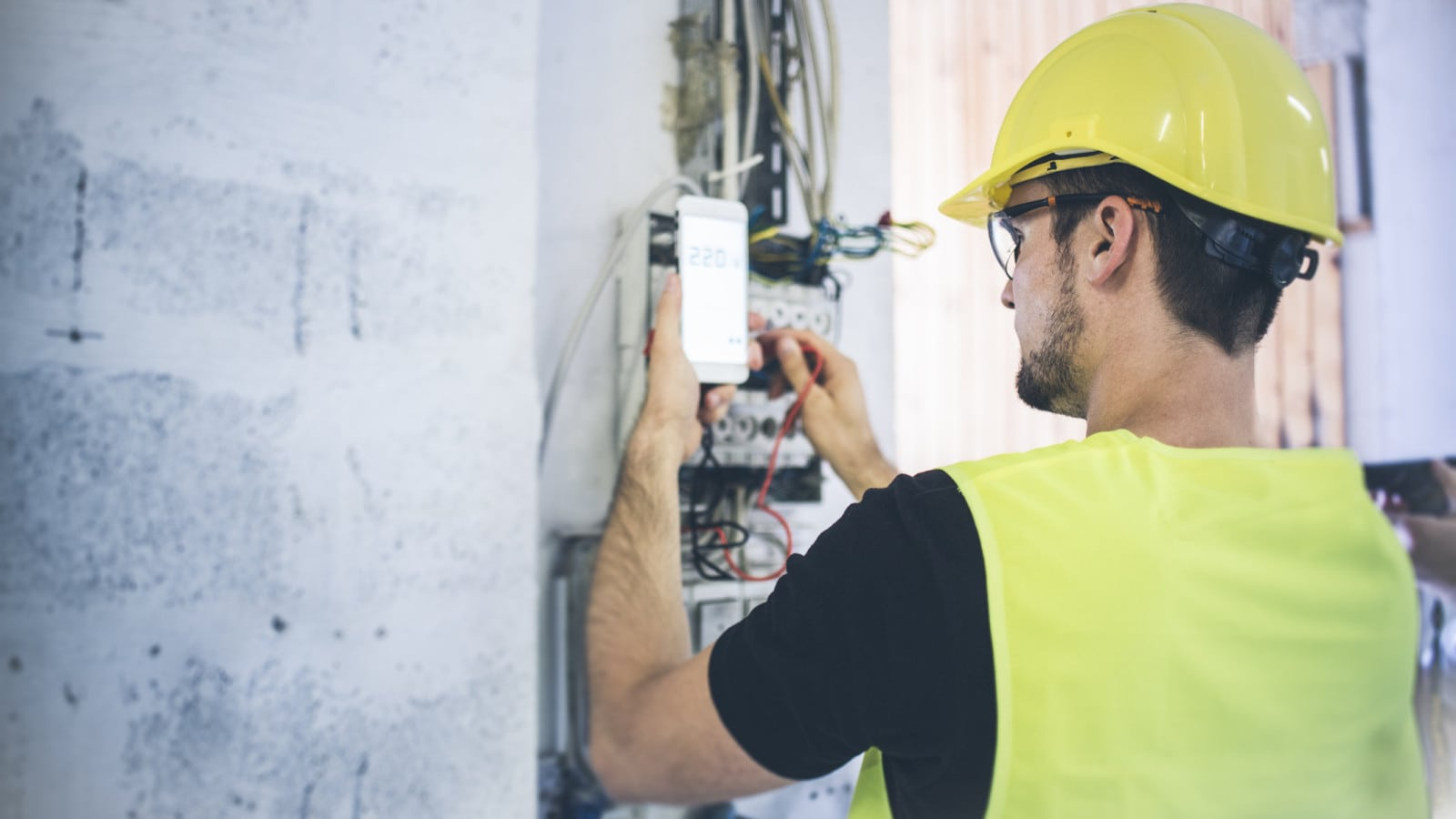 Electrician Working Outdoors Stock Photo