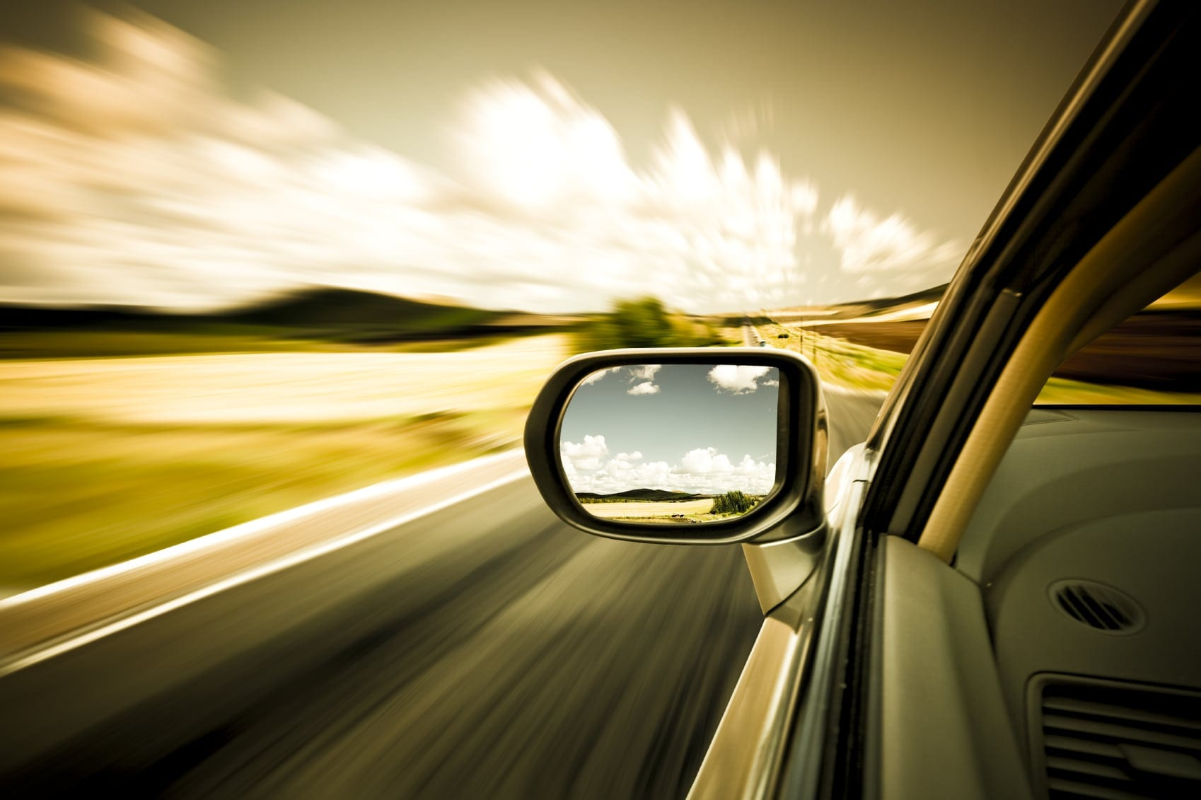 Side Mirror Of A Moving Vehicle Stock Photo