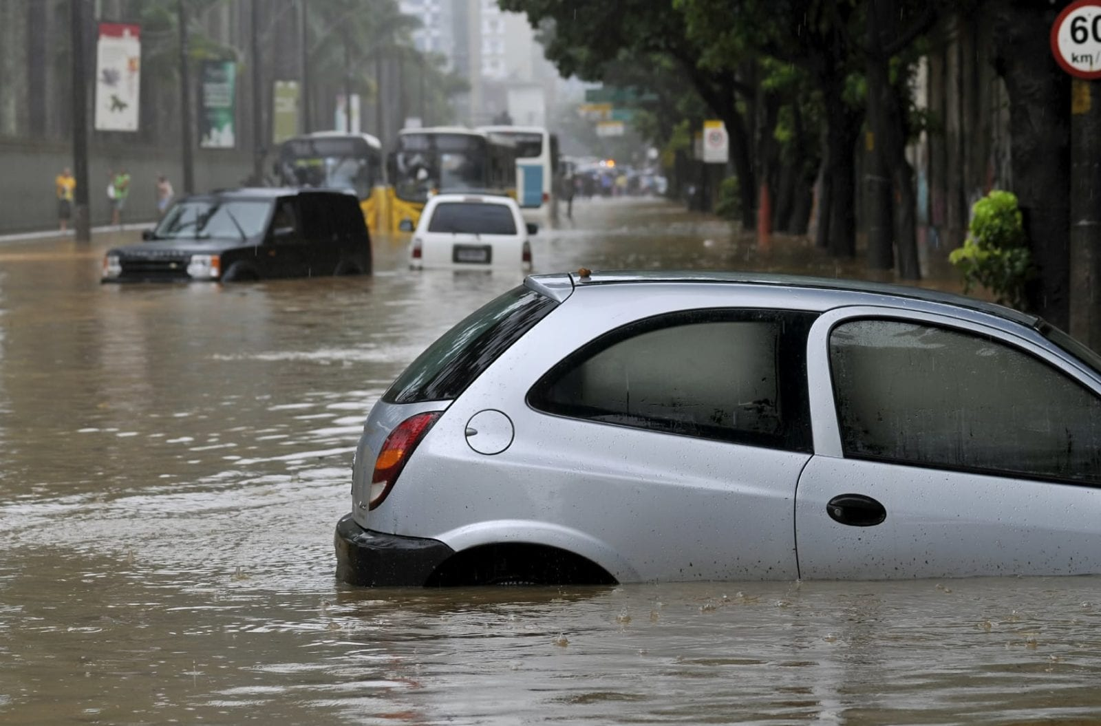 Cars Sinking In Flood Waters Stock Photo
