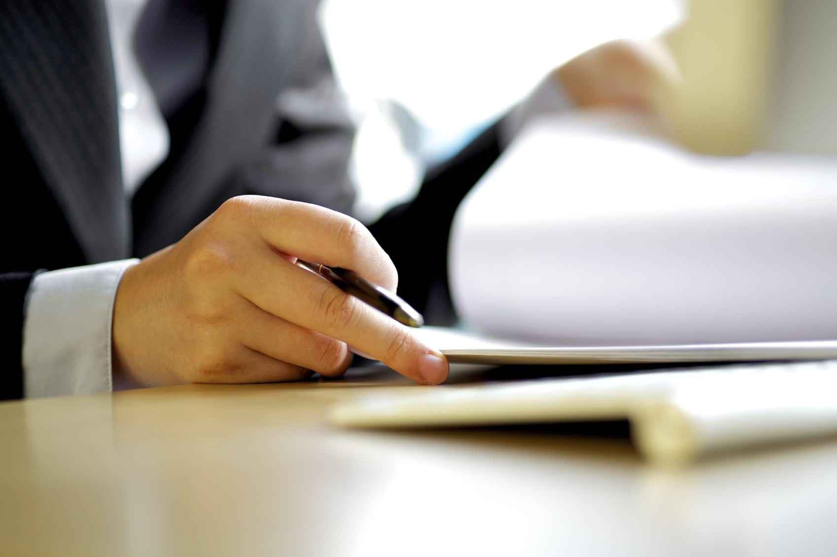 Car Accident Lawyer Examining Legal Documents Stock Photo