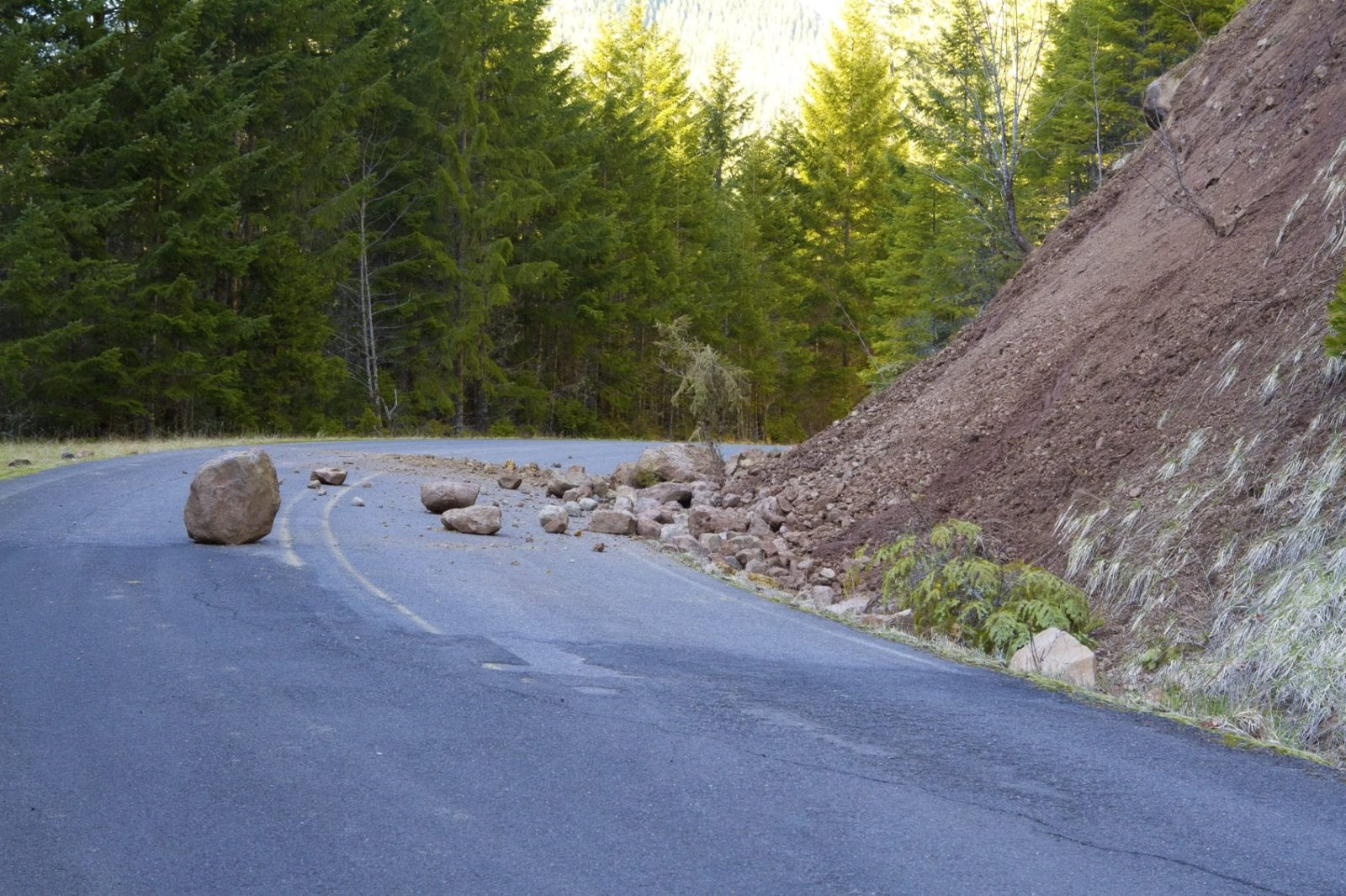 Falling Rocks On A Rural Road Stock Photo