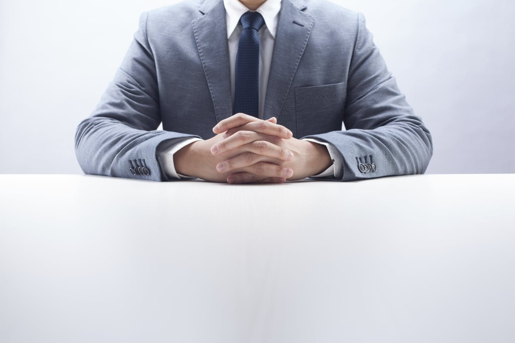 Lawyer In A Nice Suit Sitting By Himself Stock Photo