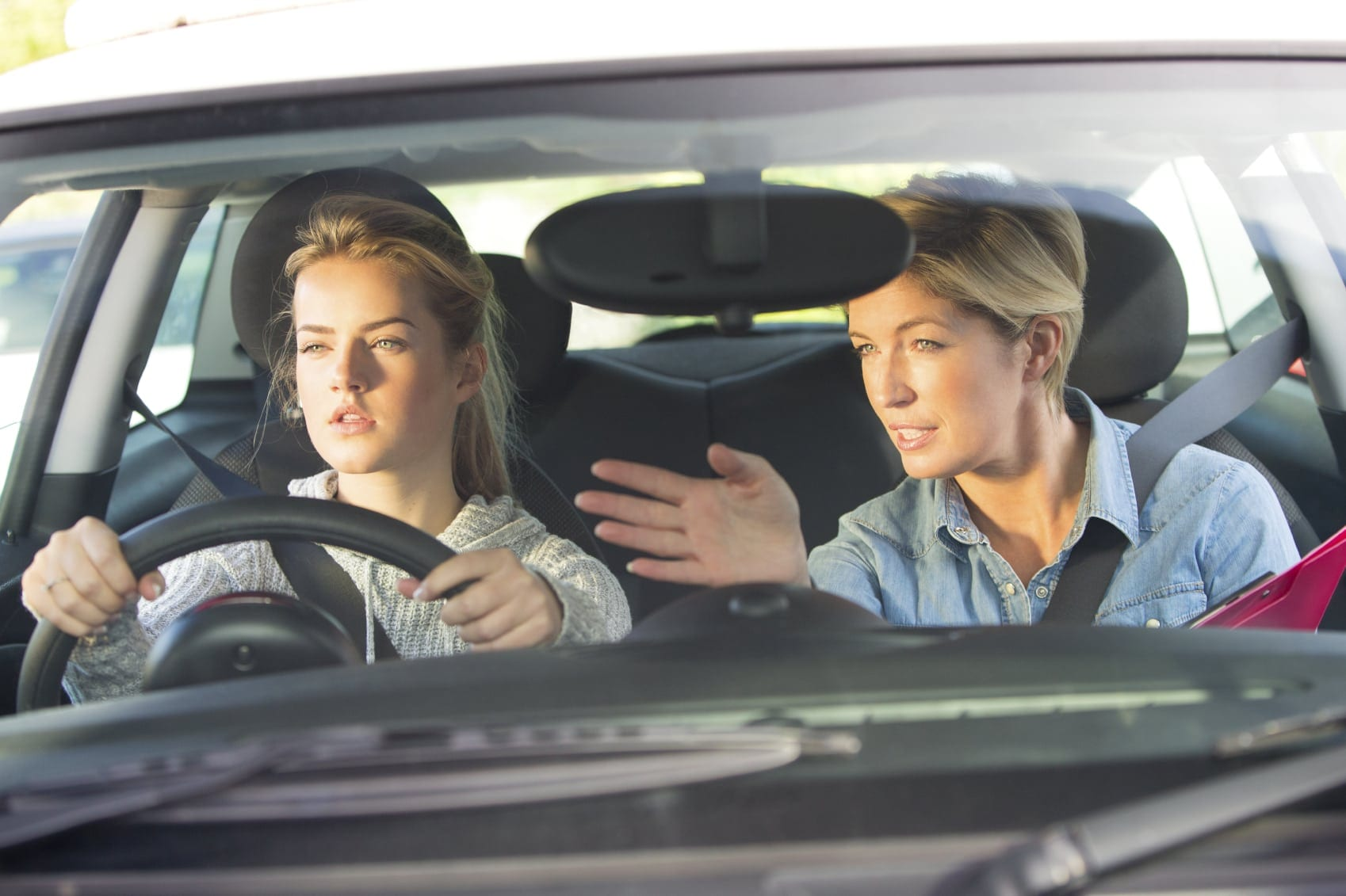 Mother Showing Daughter How To Drive Stock Photo