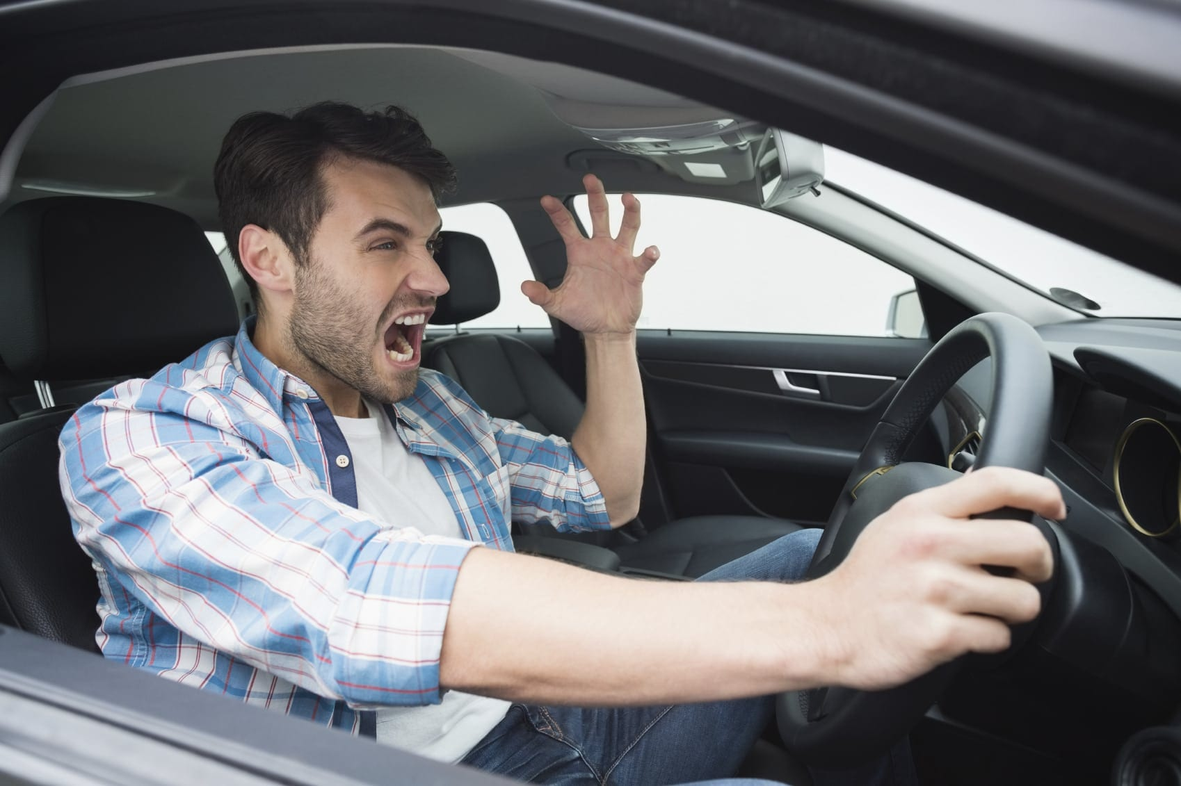 Man Screaming While Driving Stock Photo