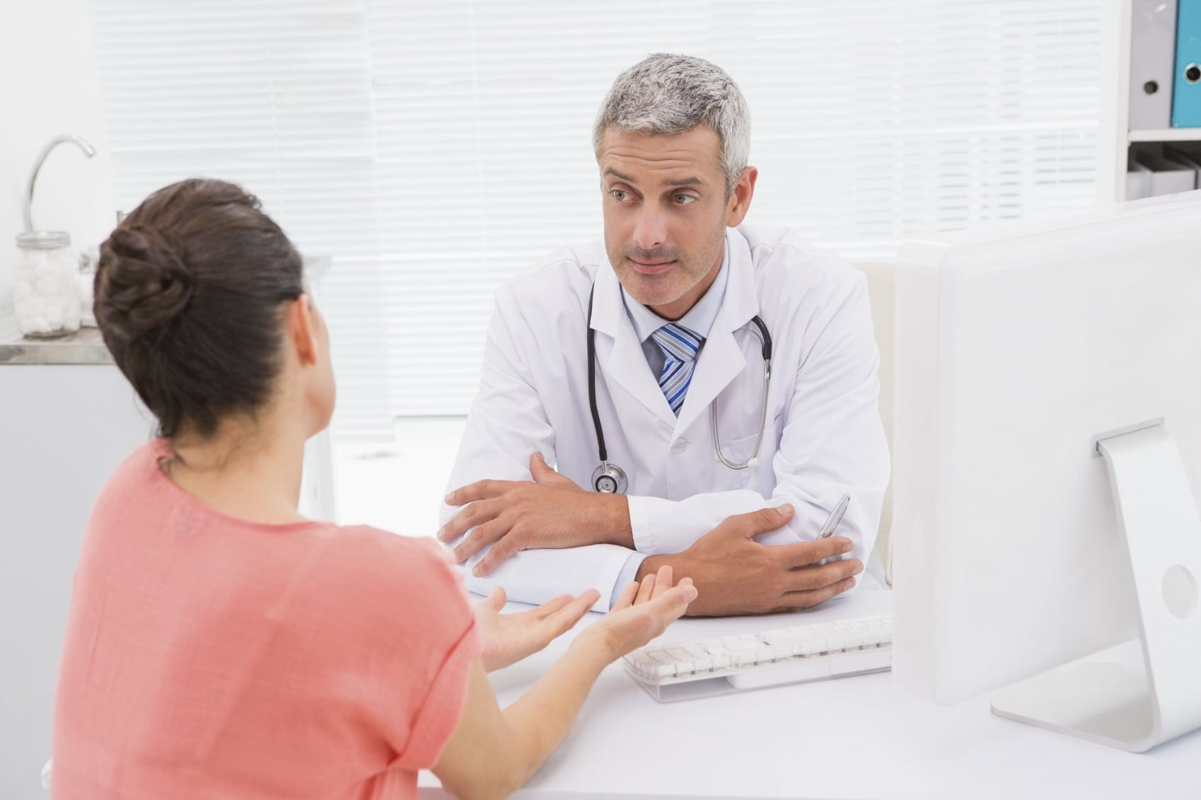 Doctor Meeting With A Patient In His Office Stock Photo