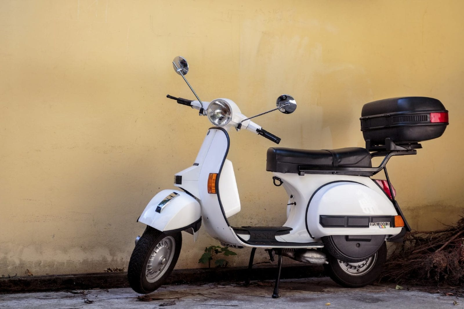 Moped Parked In An Alley Stock Photo