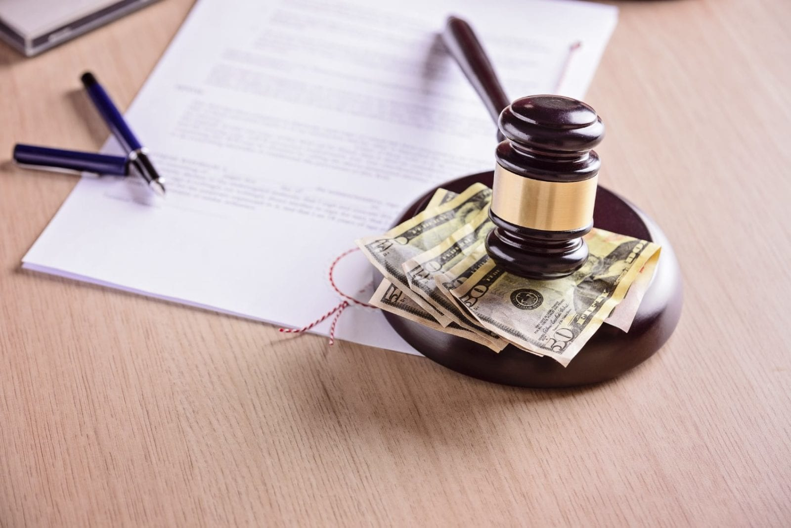Wooden Gavel Laying On Top Of Money Stock Photo