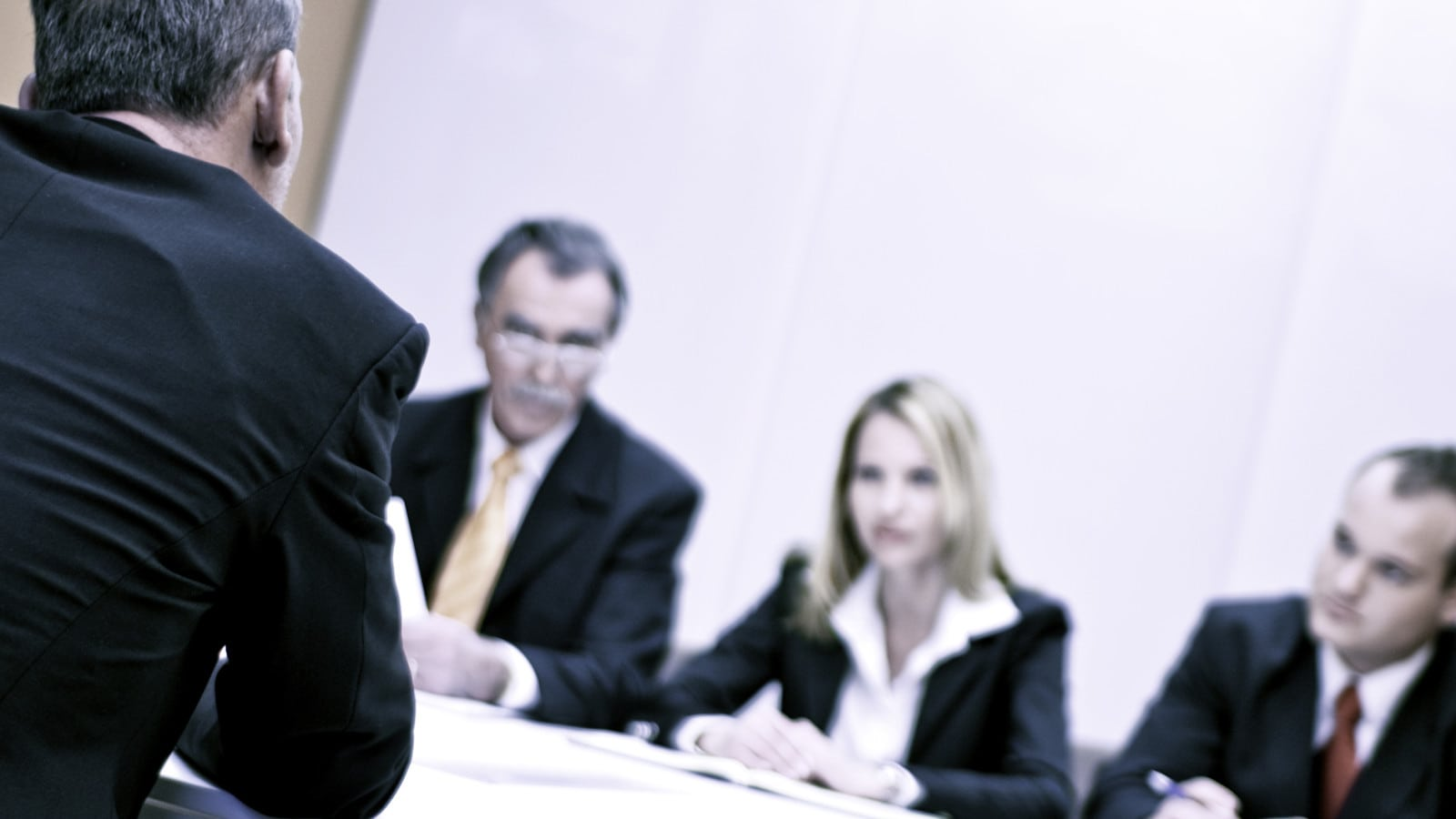 Attorneys Meeting Together Privately In A Boardroom Stock Photo