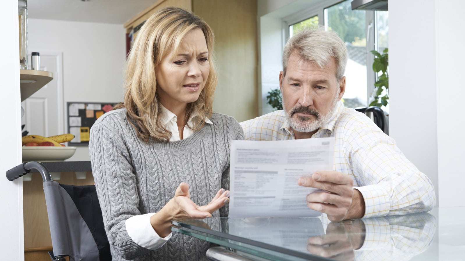 Frustrated Couple Examining Medical Bills Stock Photo