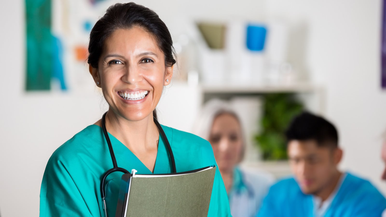 Female Doctor Smiling At The Camera Stock Photo