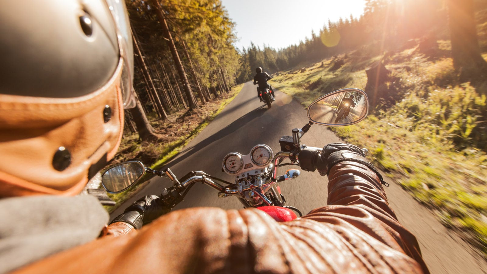 Motorcyclists Riding Motorcycles Together Stock Photo
