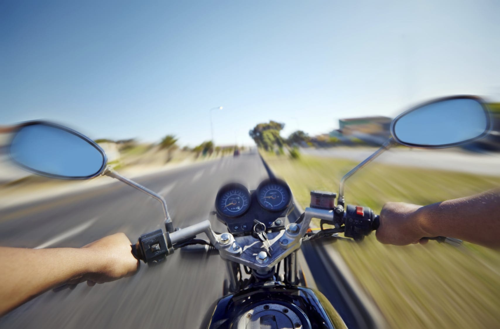 Man Riding A Motorcycle On The Highway Stock Photo