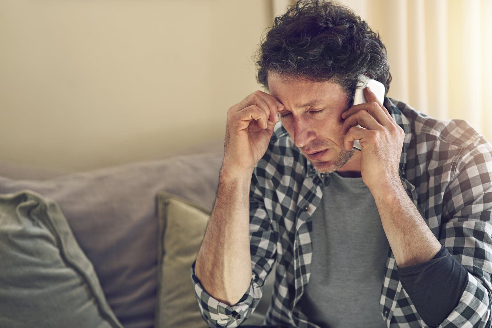Man Talking On Cell Phone With Worried Look Stock Photo