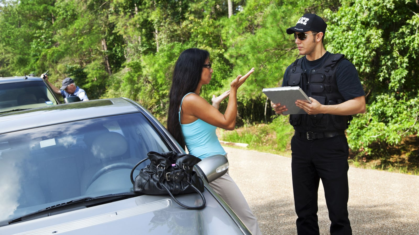 Policeman Questioning A Woman Stock Photo