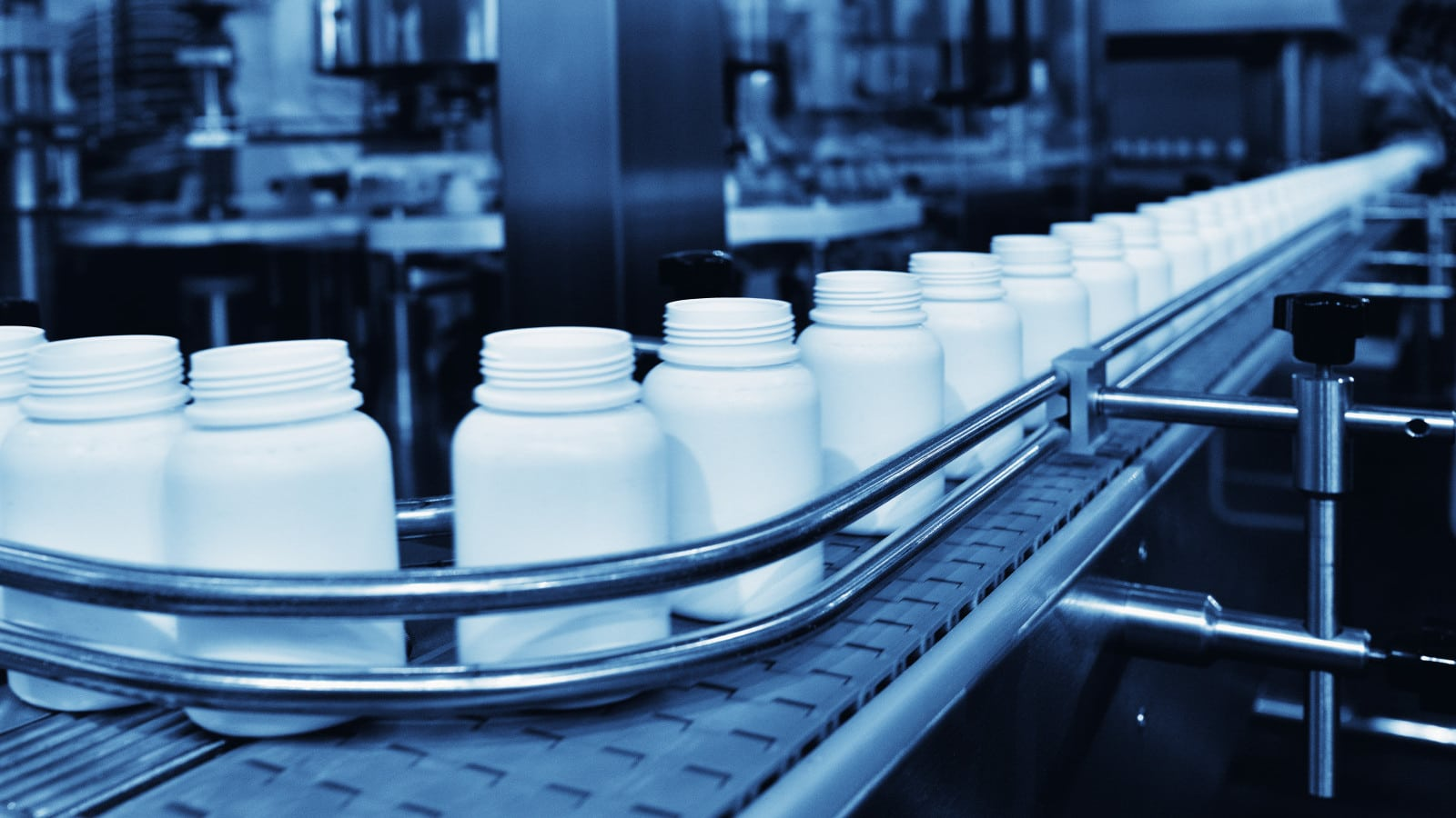 Medicine Bottles On Automated Assembly Line Stock Photo