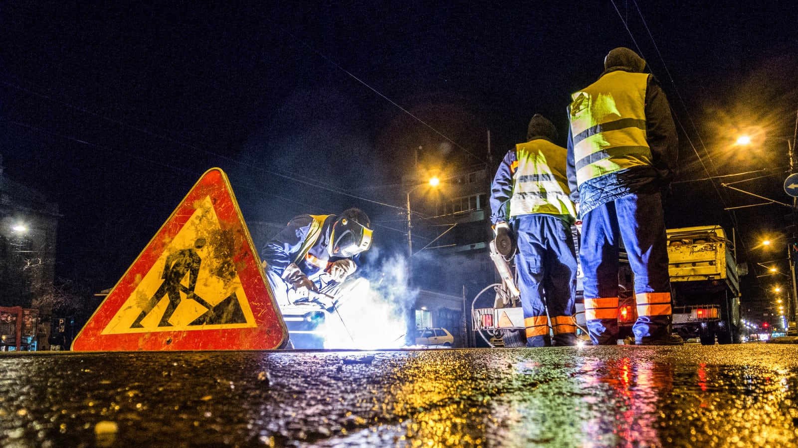 Road Workers Working At Night Stock Photo