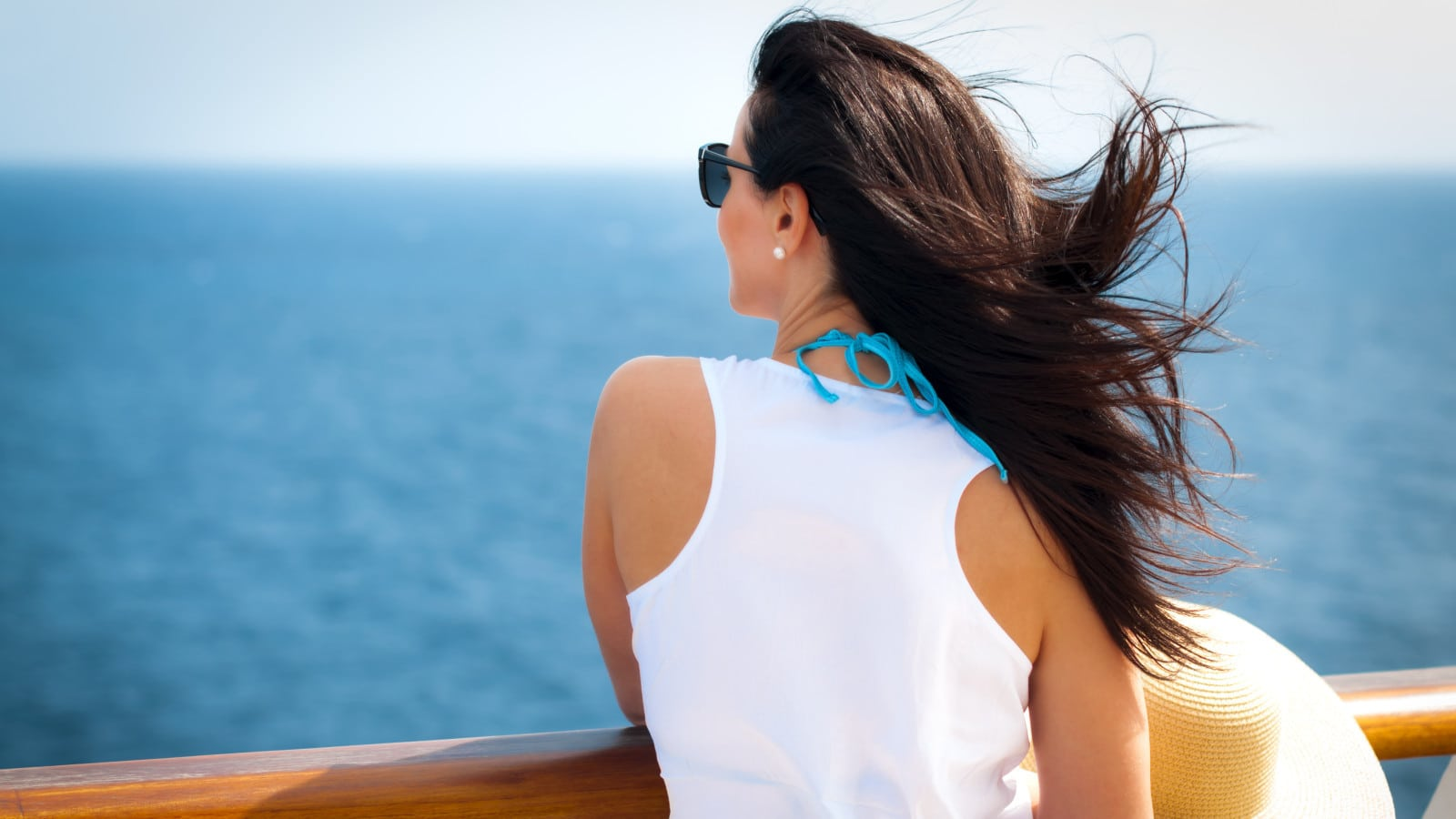 Woman On Deck Of A Cruise Ship Stock Photo