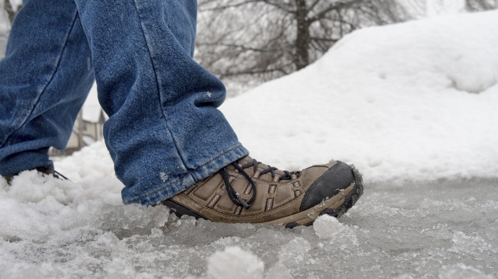 Man Walking On An Icy Sidewalk Stock Photo