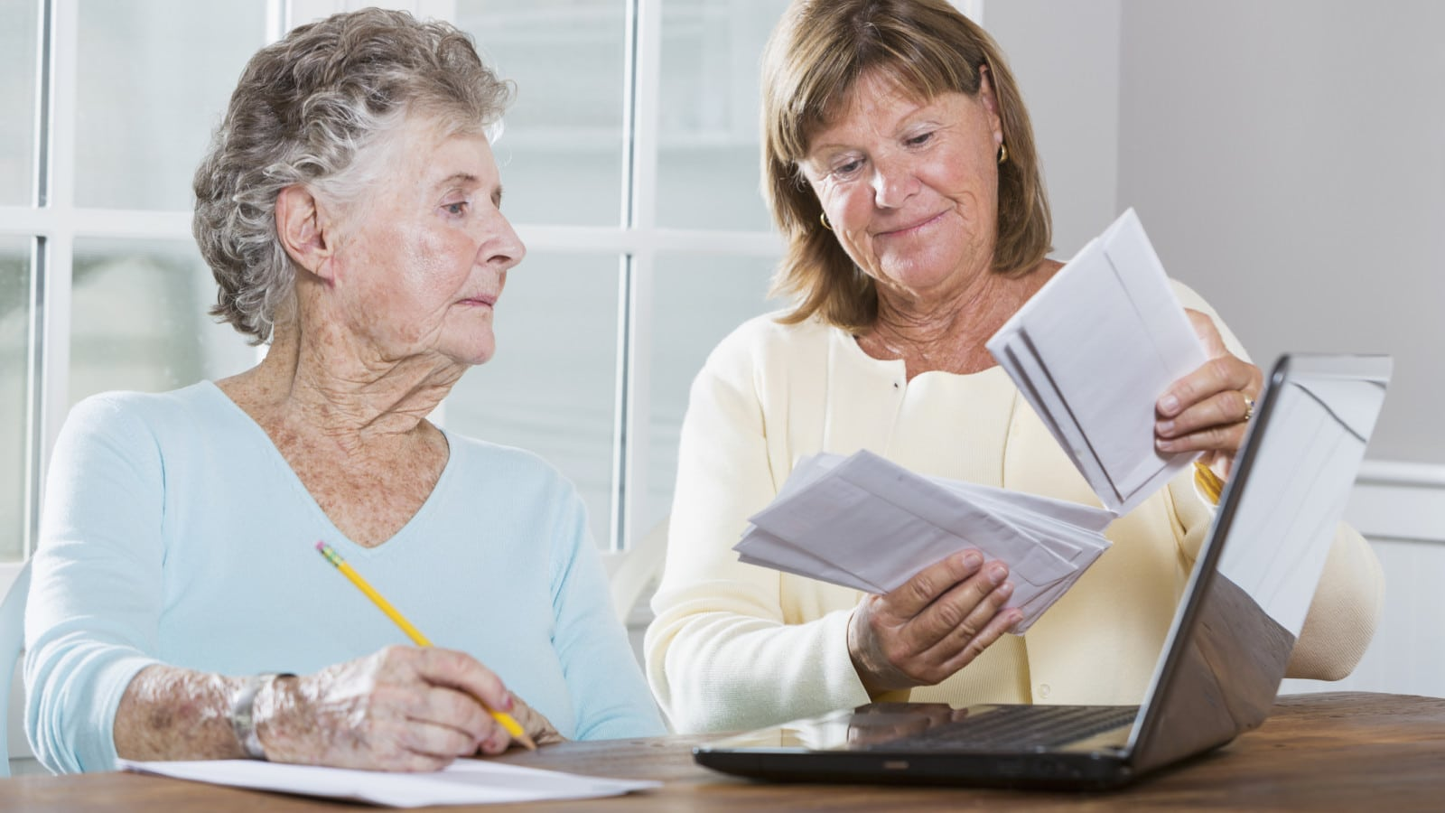Elderly Women Paying Bills Stock Photo