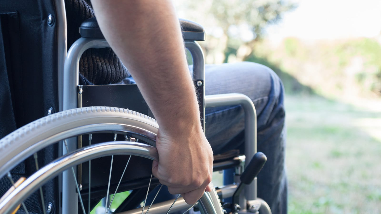 Paralyzed Man In a Wheelchair Stock Photo