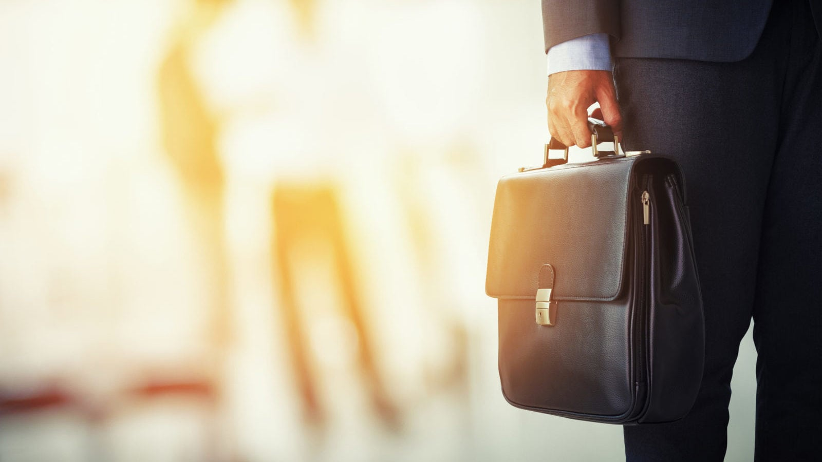 Businessman Holding His Briefcase Stock Photo