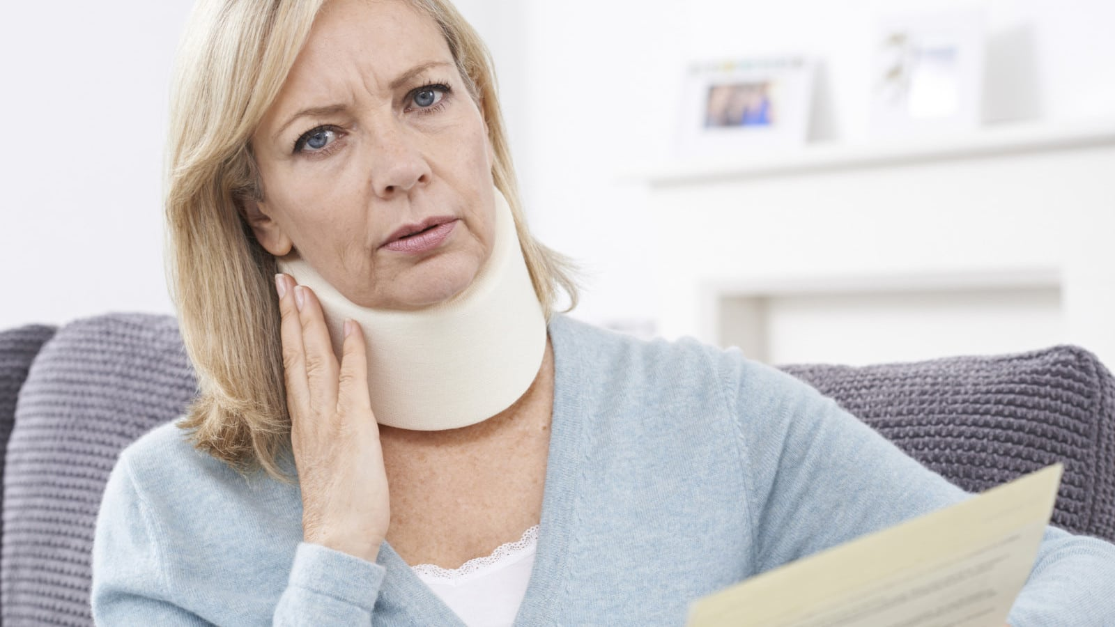 Mature Woman Wearing Neck Brace Stock Photo