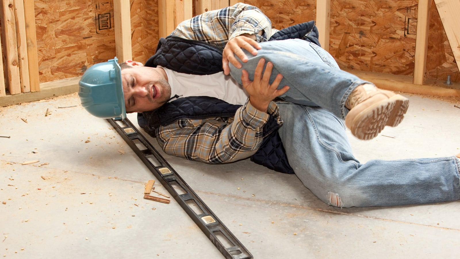Construction Worker Knee Injury Stock Photo