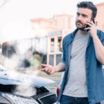 a man calling a lawyer after a car accident in Greenville, SC